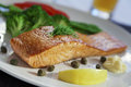 Salmon steak and cookeg vegetables Stock Photo