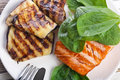 Salmon steak with eggplant and spinach Stock Photo