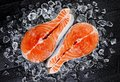 Salmon steak on ice, top view Royalty Free Stock Photo