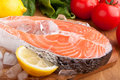 Salmon steak with lemon on ice Royalty Free Stock Photos