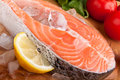 Salmon steak with lemon on ice Stock Image