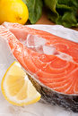 Salmon steak with lemon on ice Royalty Free Stock Photo
