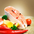Salmon steak with lemon, pepper and parsley Royalty Free Stock Photo