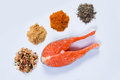 Salmon steak with spices and seasonings prepared top view Stock Photo