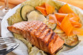 Salmon steak with steamed vegetables Stock Images
