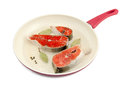 Salmon steaks in a frying pan Royalty Free Stock Photo