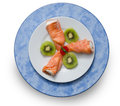 Salmon white smoked stuffed with cream cheese garnished with avocado isolated on background Stock Photos