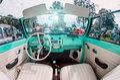 Salon white, turquoise beetle car. Russia, Saint-Petersburg July 2016. Royalty Free Stock Photo