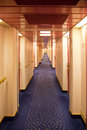 Saloon deck on a liner long corridor with passenger cabins Royalty Free Stock Photos