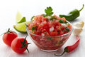 Salsa dip bowl of fresh and ingredients on white wooden background Stock Photo