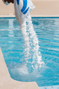 Salt being added to a brine swimming pool Royalty Free Stock Photo
