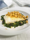 Salt-cod with chickpeas,spinach and pine nuts Stock Photos