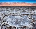 Salt flats at sunrise badwater basin in death valley national park california Stock Photos