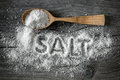 Salt food on a wooden surface Royalty Free Stock Images