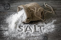 Salt food on a wooden surface Royalty Free Stock Photo