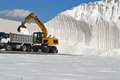 Salt loaded into lorry loading a with sea Royalty Free Stock Photography