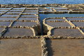 Salt pans evaporation ponds located near qbajjar on the maltese island of gozo Stock Image