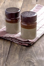 Salt and pepper shakers rustic table with Stock Image