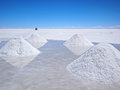 Salt piles with reflection on the salar Stock Photos