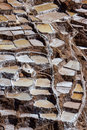 Salt ponds of maras peru in covering a hillside with rich minerals and a economy boost for the country and people Stock Image