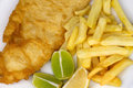 Salted french fries with large serving of fried fish with lemon overhead view traditional and chips meal chips battered and and Royalty Free Stock Photos