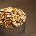 Salted peanuts in focus nuts a small metal bowl Royalty Free Stock Photo