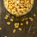 Salted peanuts in focus nuts a small metal bowl Royalty Free Stock Images