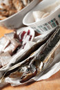 Salted smelt fish and herring fillet assorted on wooden table Stock Image