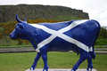 Saltire cow the crags parade is an international public art exhibition that has been held in many world cities here is pictured Stock Image