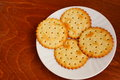 Salty crackers round served on white plate Stock Photo