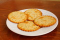 Salty crackers round served on white plate Royalty Free Stock Image