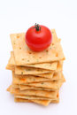Salty crackers with tomato vegetable on white background Stock Photos