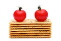 Salty crackers with tomato vegetable on white background Royalty Free Stock Photos
