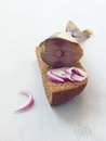Salty herring and red onion upon slice of fresh rye bread. Royalty Free Stock Photo