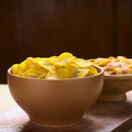 Salty plantain chips bowls of front and sweet back a popular snack in south america photographed with natural light selective Stock Photography