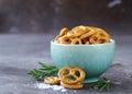 Salty snacks mini pretzels with salt Royalty Free Stock Photo