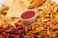 Salty snacks and salsa dip Royalty Free Stock Photo