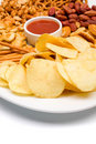 Salty snacks served on a plate Royalty Free Stock Images