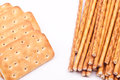 Salty stick and biscuit crackers on a white background Stock Image