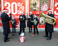 Salvation army band collecting for christmas on oxford street london Stock Photo