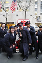 Salvation army soldiers perform for collections in midtown manhattan new york december on december this christian organization is Royalty Free Stock Photo