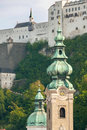 Salzburg Castle framed by church towers III Royalty Free Stock Photo