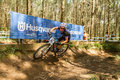 Samantha saunders practicising during uci mtb wc pietermaritzburg south africa march riding a berm round of xco mountain bike Royalty Free Stock Photography