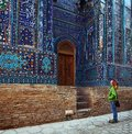 Samarkand young lady tourist watching ancient ornament of ancient complex of shah i zinda uzbekistan Stock Photography
