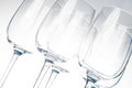 Same empty wine glasses several in gray shades Stock Images