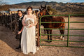 Same sex couple by horse smiling bride with groom and Stock Photo