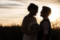 Same sex couple at sunset adult looking each other sunrise Stock Images