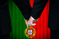 Same sex marriage in portugal two gay men stand hand hand before a altar featuring an overlay of the flag colors of having just Royalty Free Stock Photography