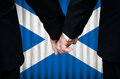 Same sex marriage in scotland two gay men stand hand hand before a altar featuring an overlay of the flag colors of having just Royalty Free Stock Image