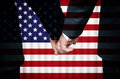 Same sex marriage in the untied states two gay men stand hand hand before a altar featuring an overlay of flag of united of Stock Image